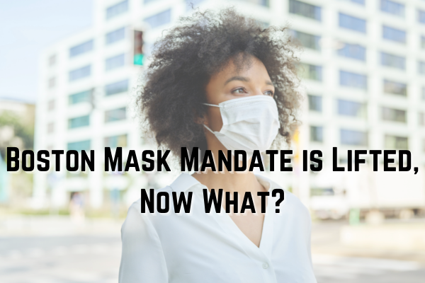 woman in city with face mask text reads boston mask mandate is lifted now what?
